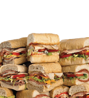 Sub sandwiches stacked.