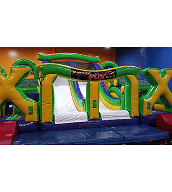 Obstacle course inflatable with a slide
