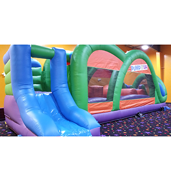 Colorful Ninja inspired obstacle course with slide.