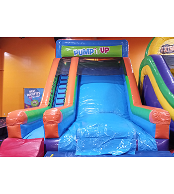 Inflatable slide with stairs on one side to climb to the top and slide down.