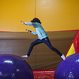 Girl has fun in a bounce house at a birthday party