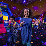 Kids celebrate during a glow birthday party