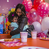 Mom and daughter share a moment at her birthday party