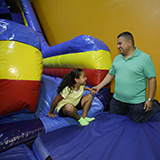 Bounce house with slide attached