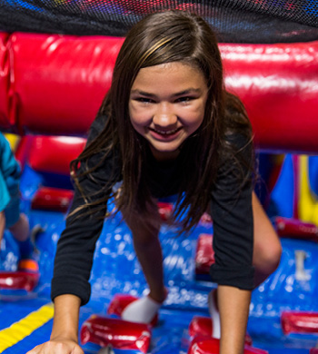 A girl at a field trip at a indoor playground with activities for kids