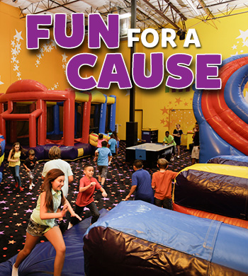 Young Kids Play in Inflatable jump houses for a good cause