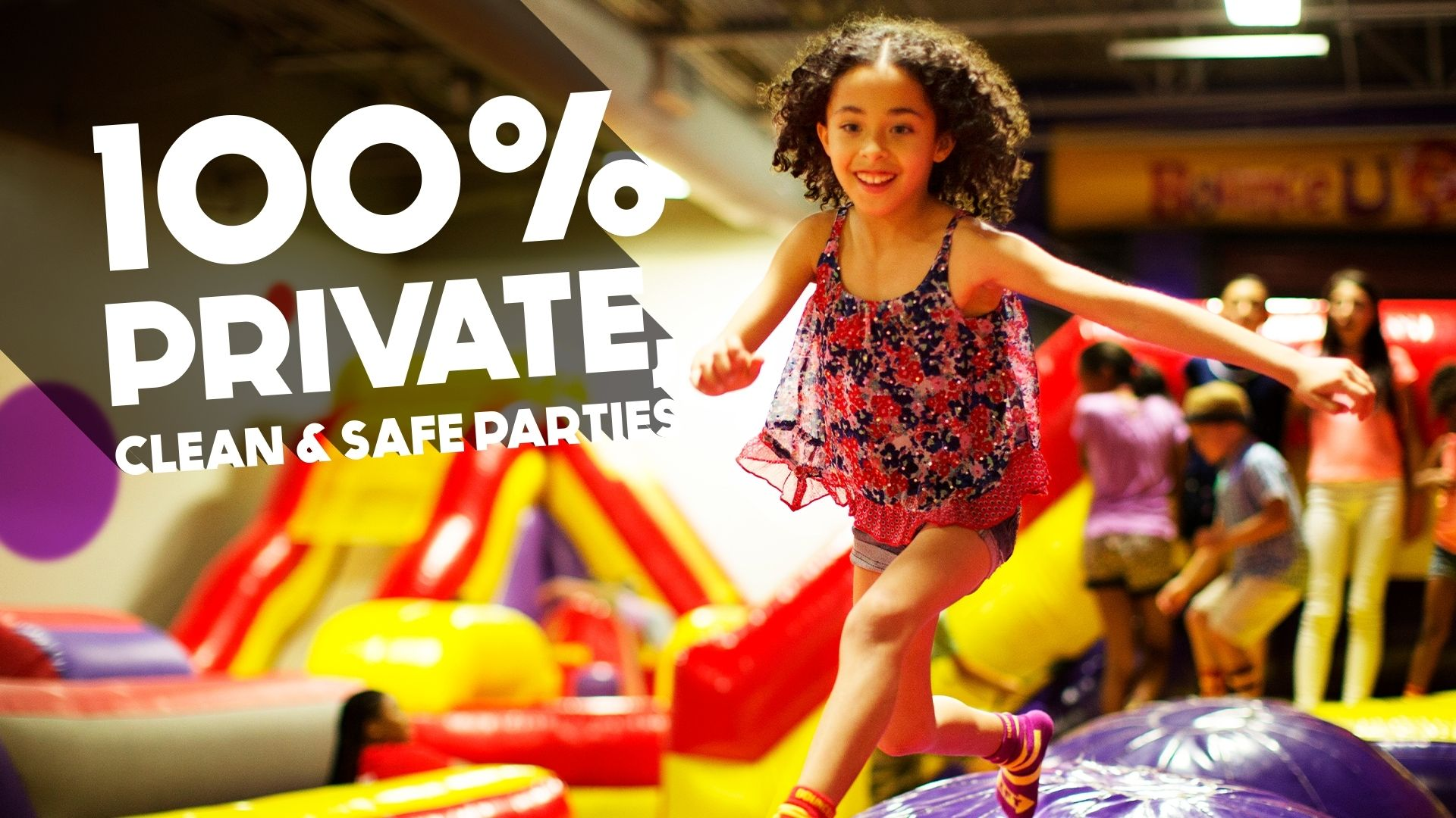 Girl jumping across Canyon Crossing inflatable at BounceU private birthday party