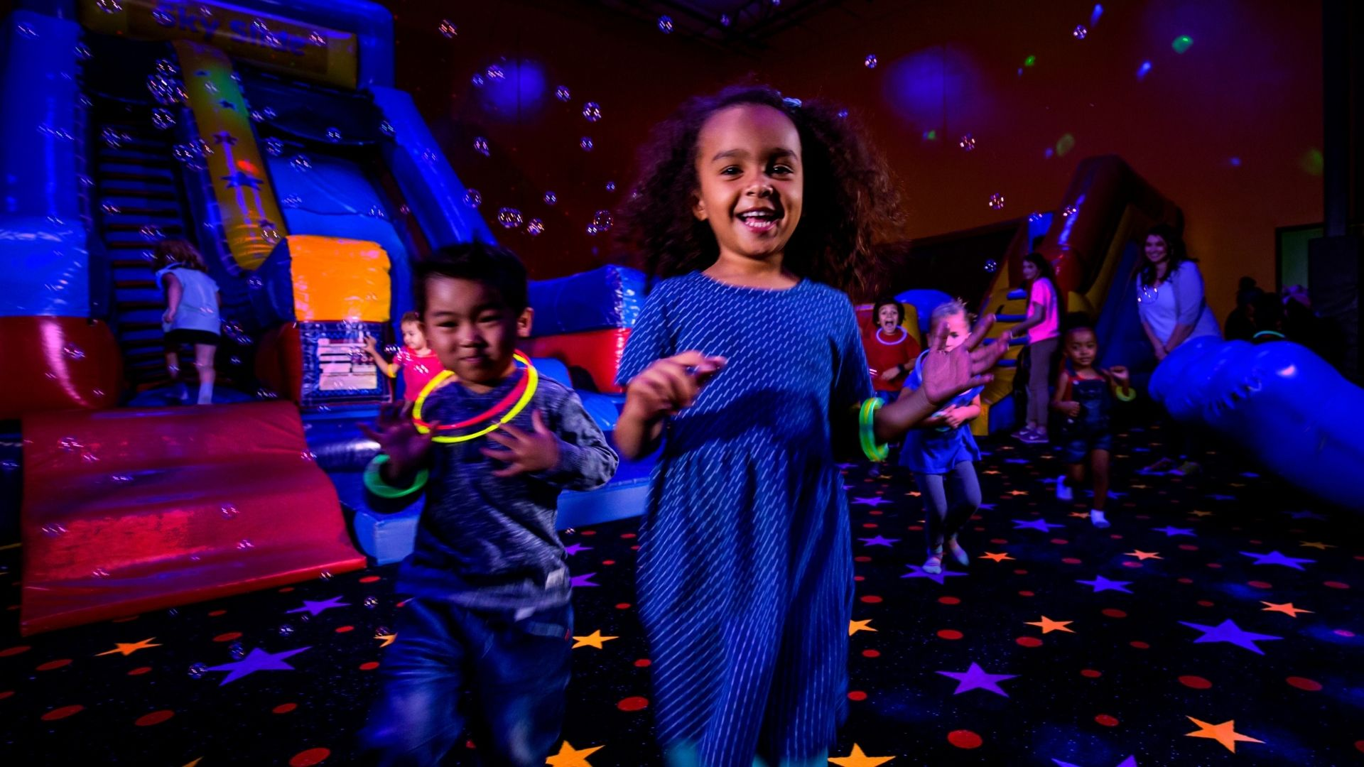 Kids celebrate at the best birthday party place with glow and bubbles