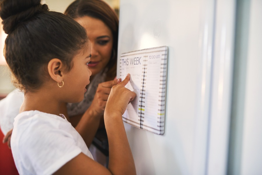 mom and daughter setting expectations and looking at checklist