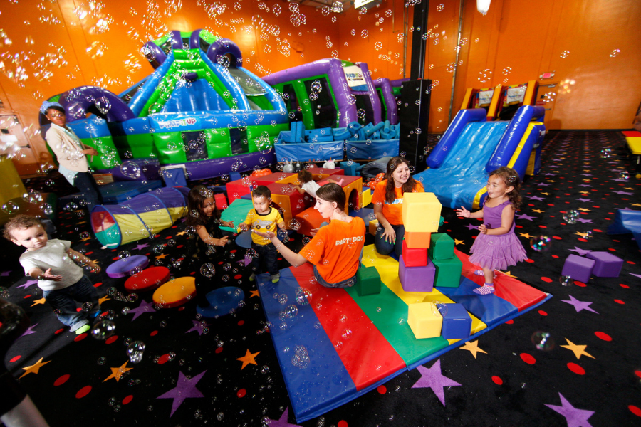 Pump It Up 100% private playdate with kids and parents playing in arena