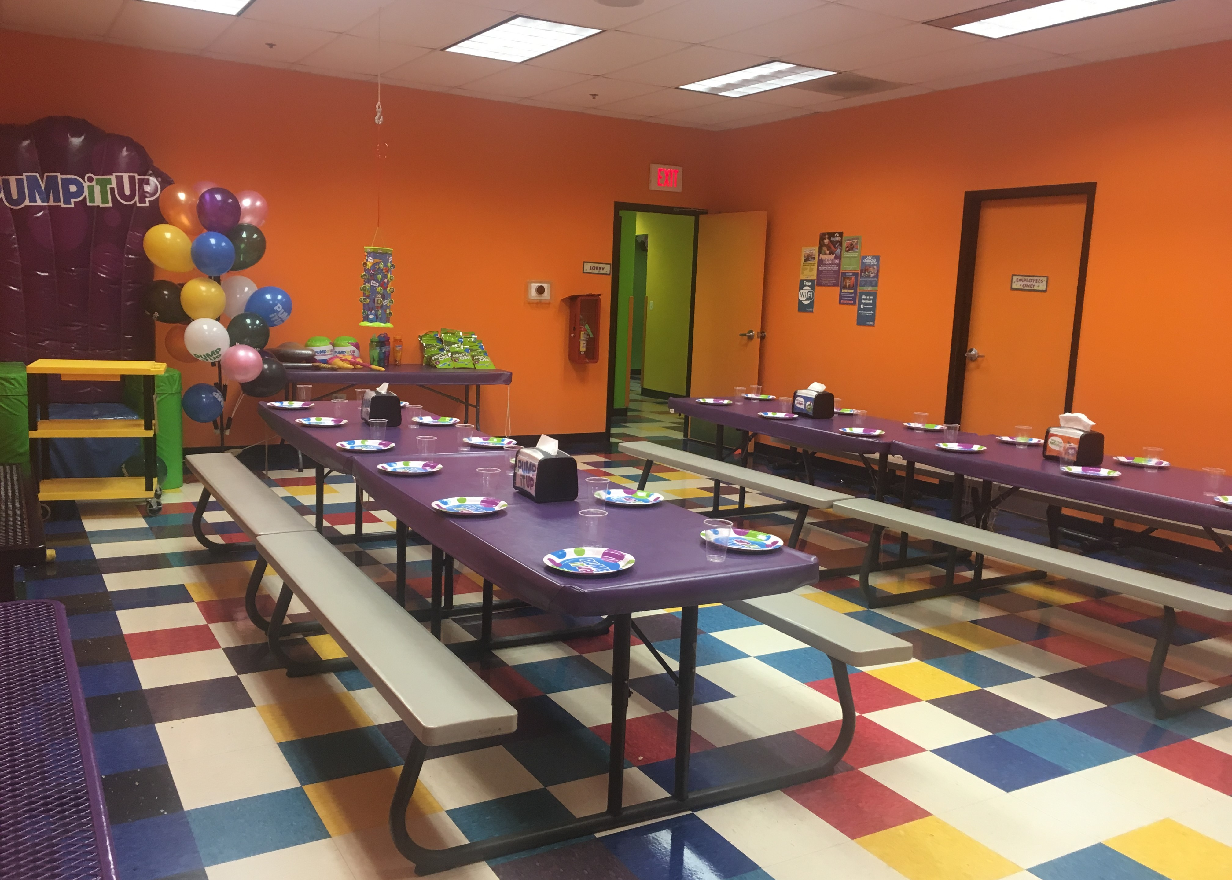 Pump It Up birthday party room with tables and birthday throne for private parties.