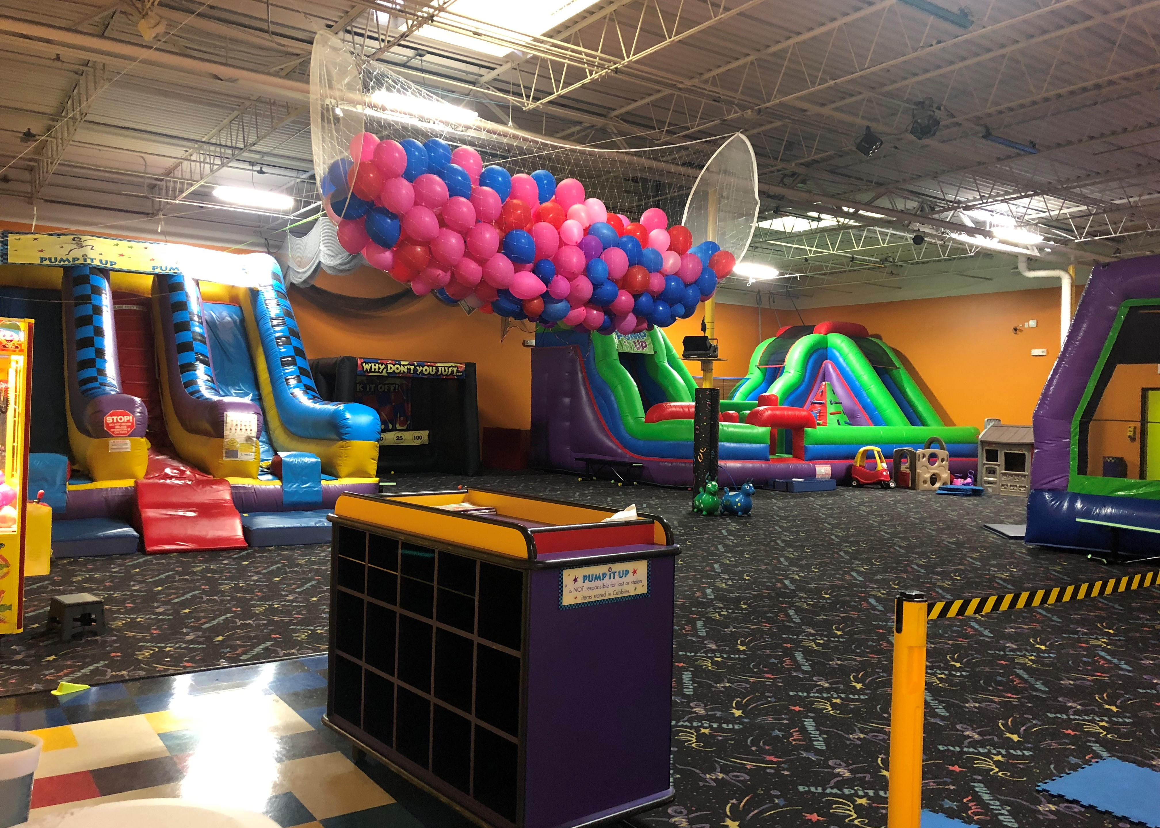 Pump It Up arena space for private parties with large inflatables and toddler play toys.
