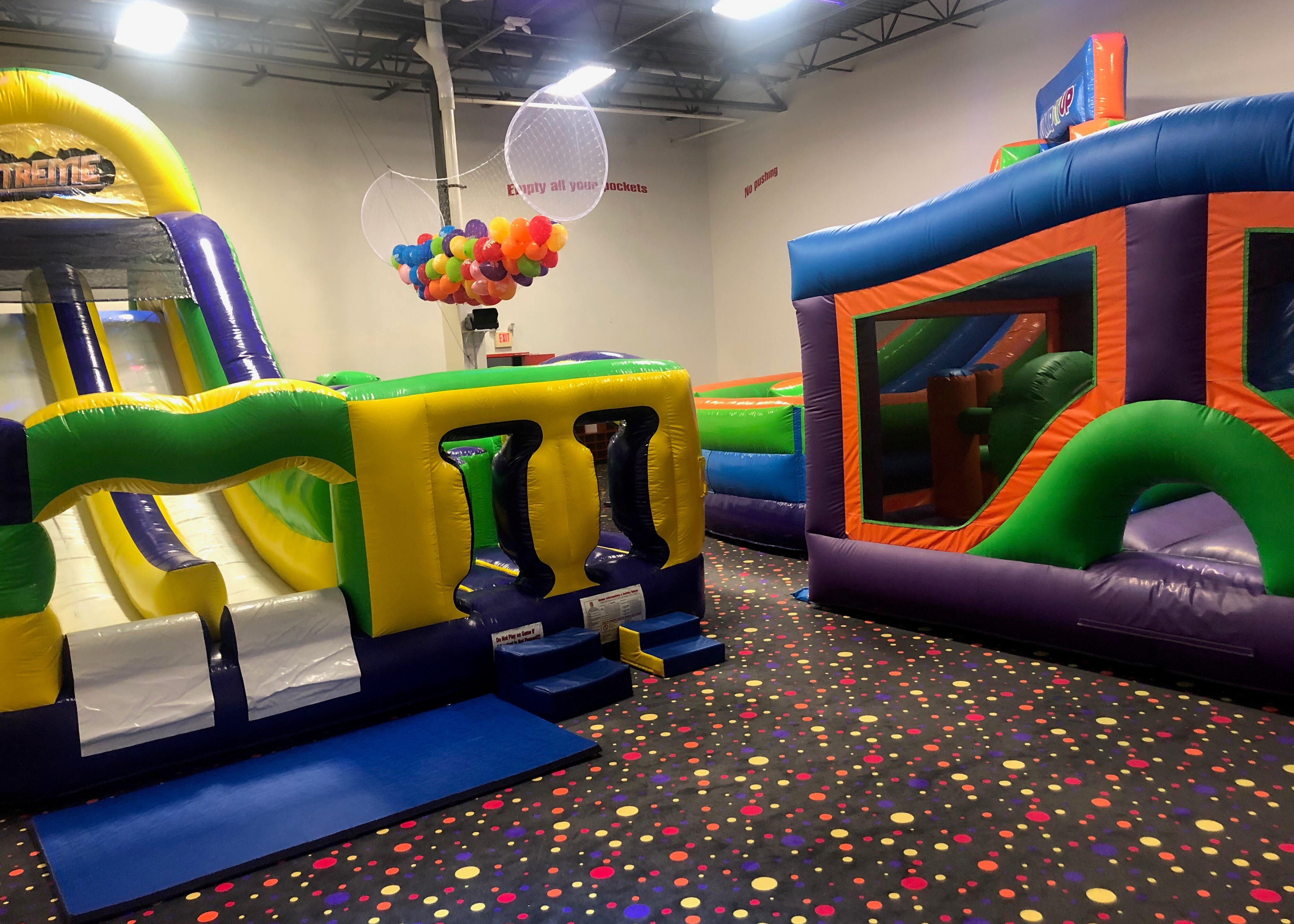 Pump It Up birthday party arena space with large inflatable rides for private birthday parties.