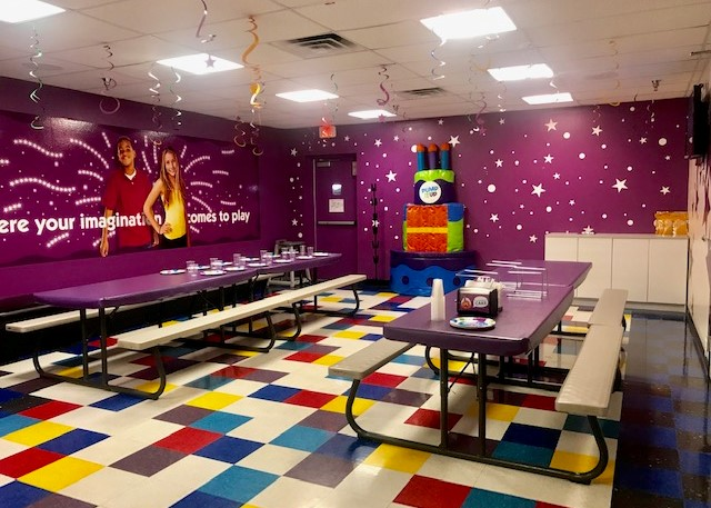 Pump It Up party room with tables and birthday throne for private birthday parties.