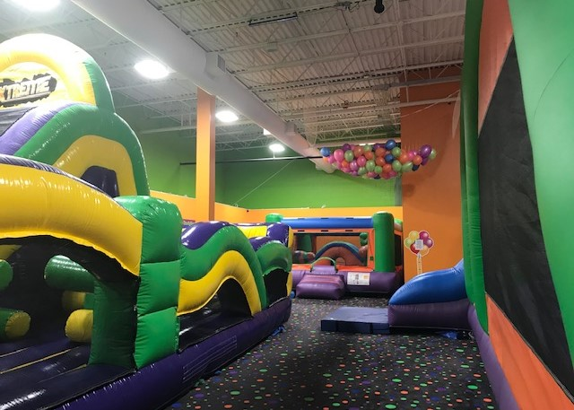 Pump It Up arena with inflatables for kids private parties.